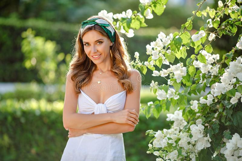Very beautiful sensual and girl in a white dress and solohe royalty free stock photography