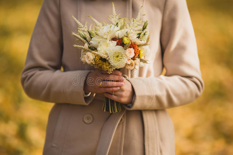 Very beautiful wedding bouquet in hands of the bride royalty free stock photos