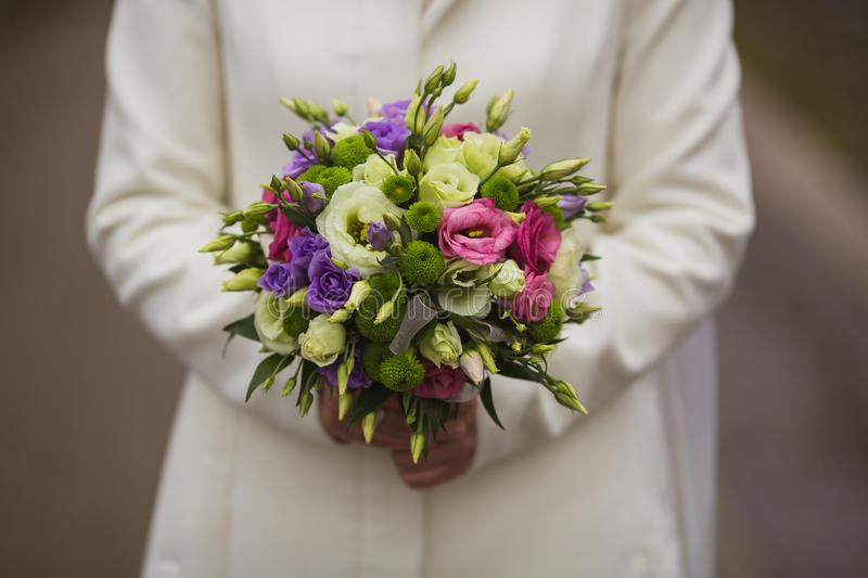 Very beautiful wedding bouquet in hands of the bride stock images
