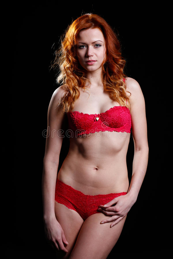 Very Beautiful Woman With Red Hair In Red Lingerie Royalty Free Stock Photos