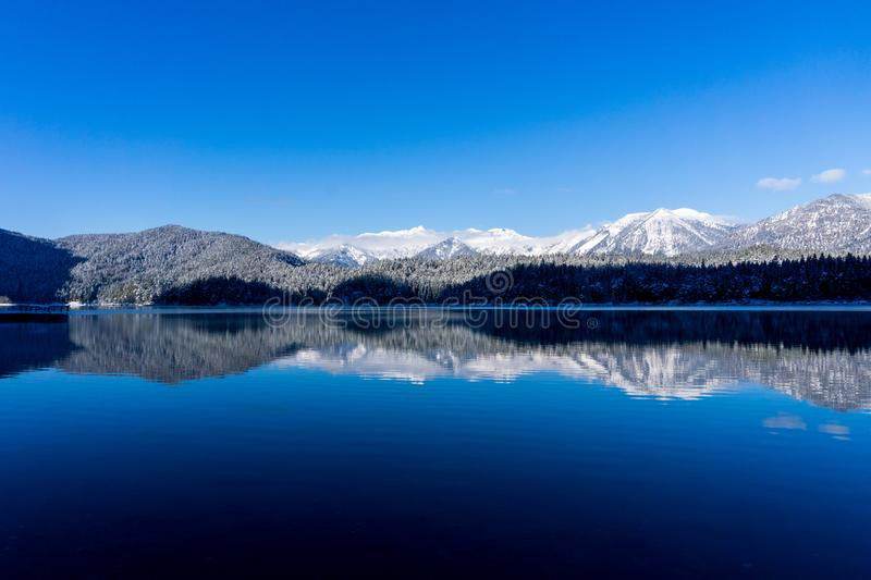 Very blue lake Eibsee during a hike in winter time royalty free stock photo