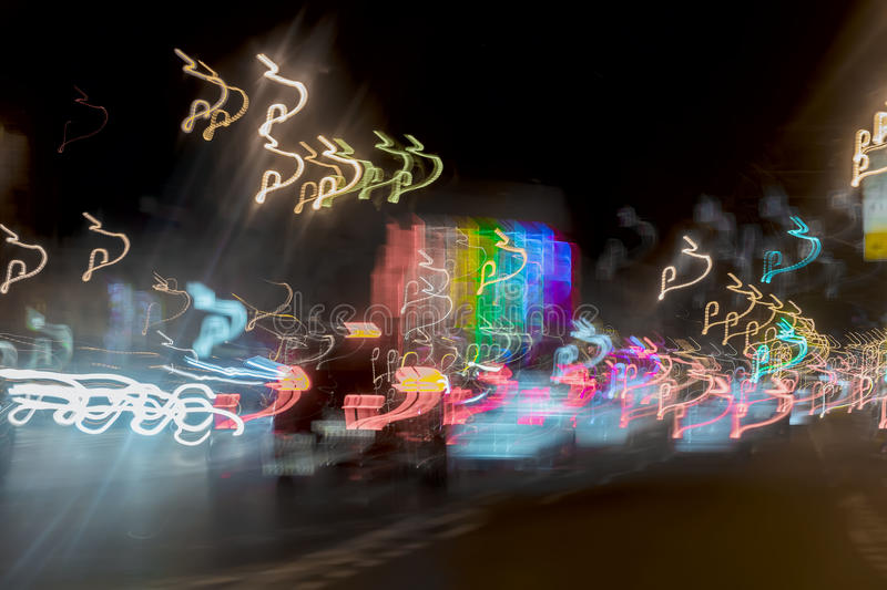 Very blurred background with lights of cars at dusk on the road of city. Transportation concept. Abstract blur bokeh. Very blurred background with lights of cars royalty free stock photos