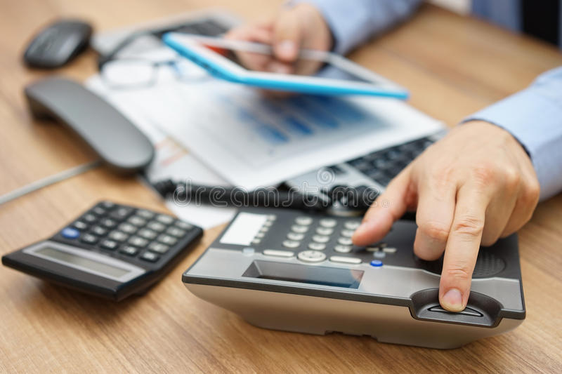 Very busy business man hanging up the phone royalty free stock photo