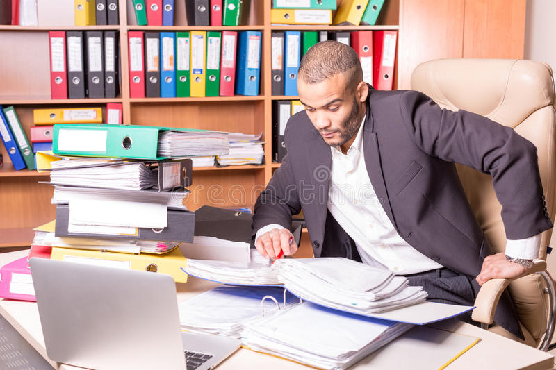 Very busy man in office royalty free stock photography