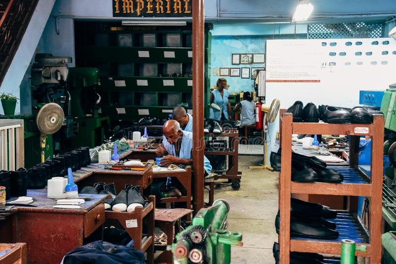 A shoe repair shop in Havana, Cuba. A very busy shoe repair shop in Havana, Cuba stock photography