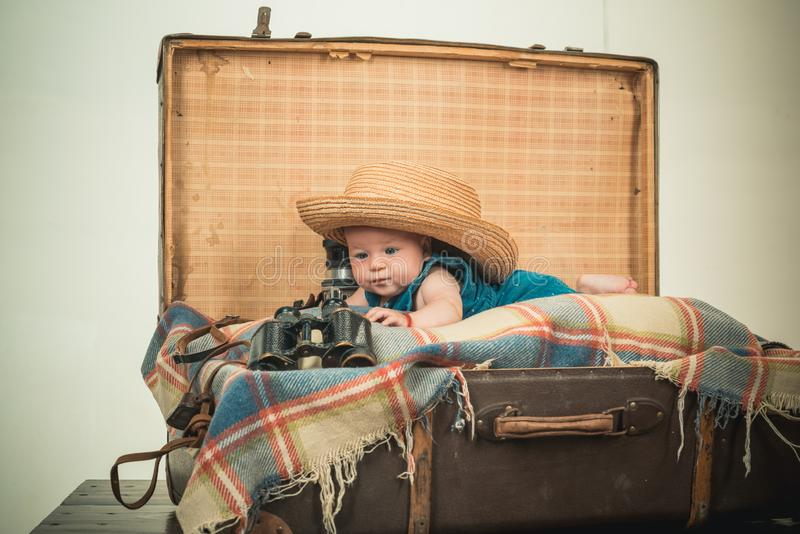 Very busy. Sweet little baby. New life and birth. Childhood happiness. Photo journalist. Small girl in suitcase royalty free stock images