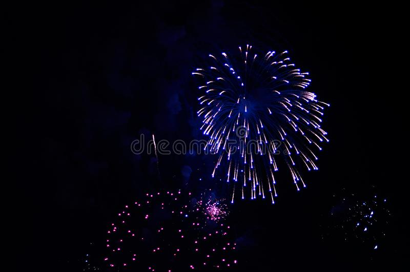 Very cheap firework over the city, purple stock photo