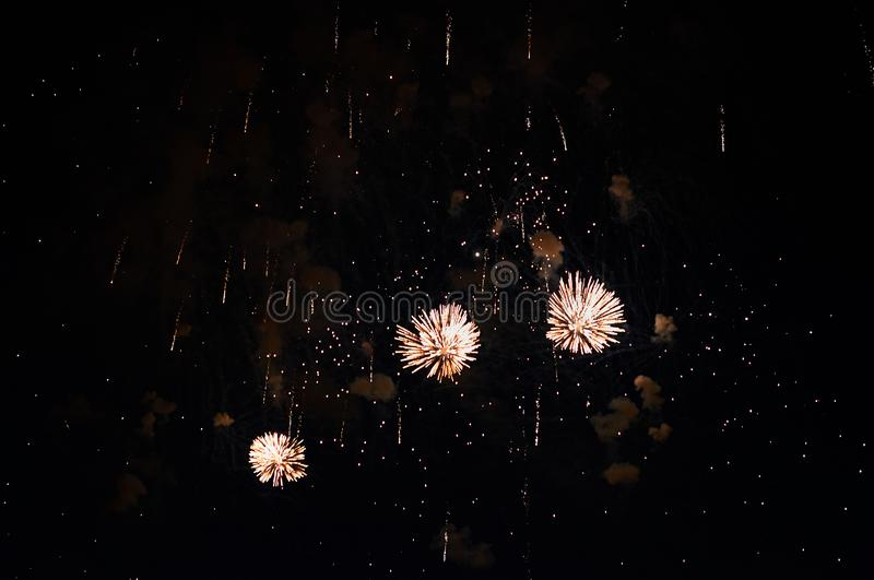 Very cheap firework over the city, yellow royalty free stock image