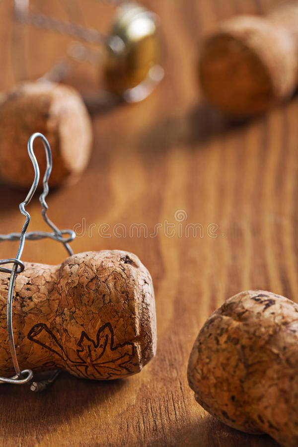 very close up view on champagne corks on wooden board stock image