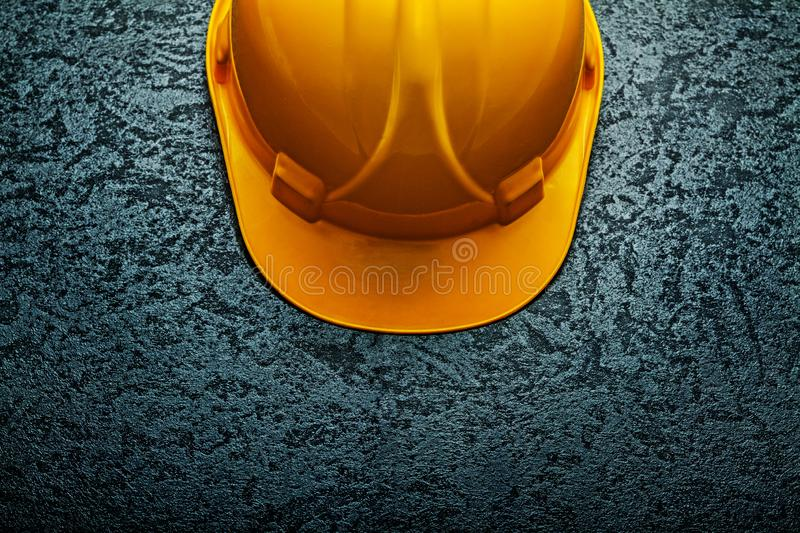 Very close up view yellow helmet on black background stock photography