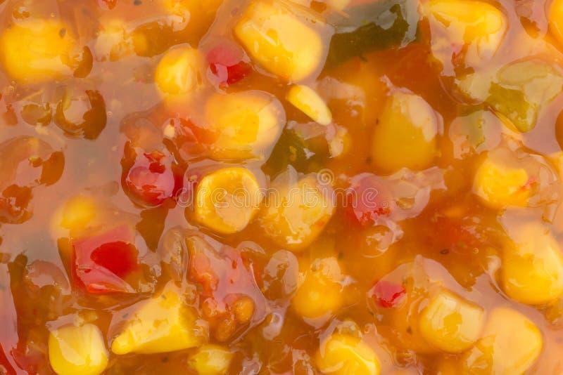 Very close view of corn relish. A very close view of corn relish illuminated with natural light stock photos