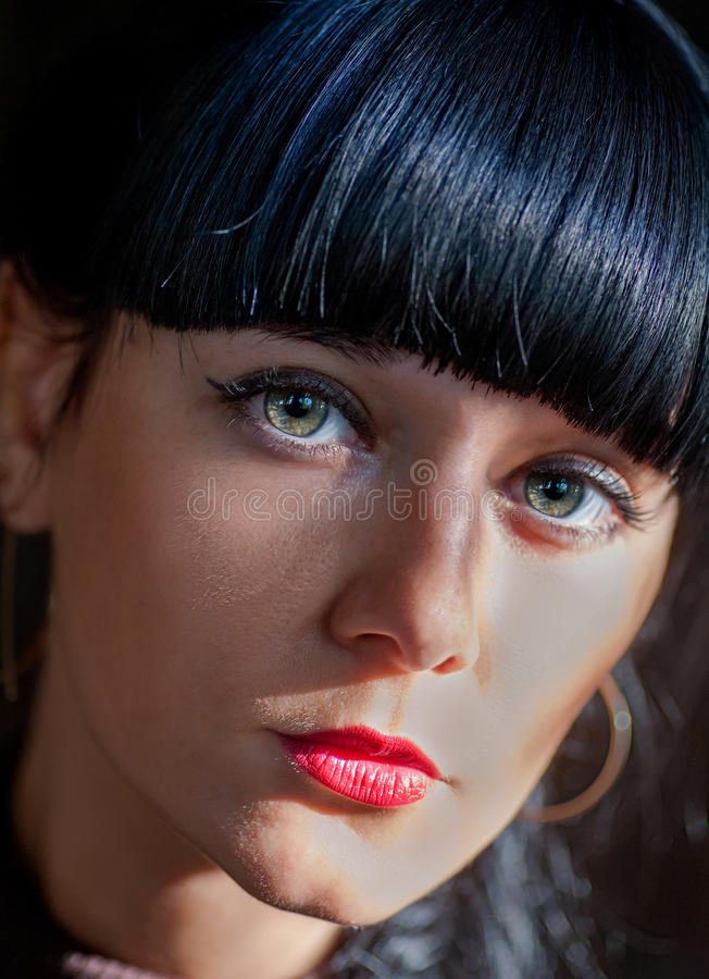 Very closeup of a young black haired women looking at camera stock image