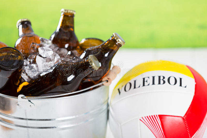 Very cold beers. Volleyball with a few beers in a very cold cube royalty free stock images