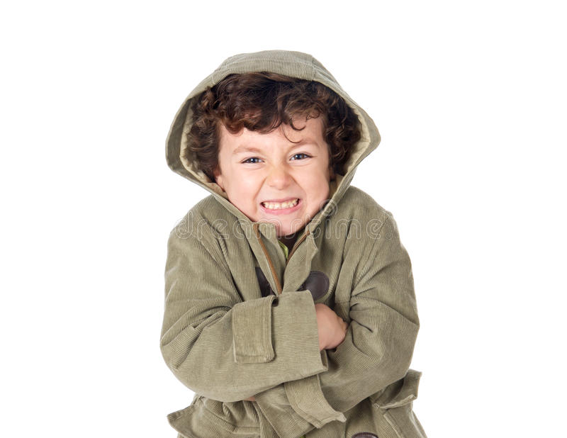 Very cold child wearing hooded coat. Isolate on a white background royalty free stock images