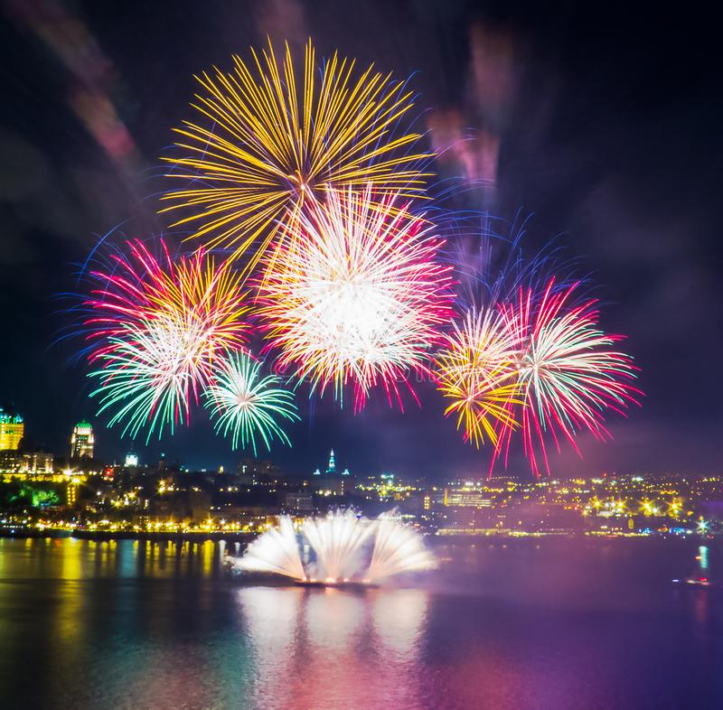 Very colorful fireworks over the Saint-Lawrence River stock images