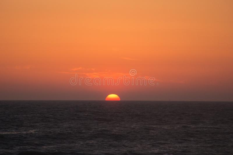 Twilight before the sun sets over Tyrrhenian sea. Amazing sunset stock photo