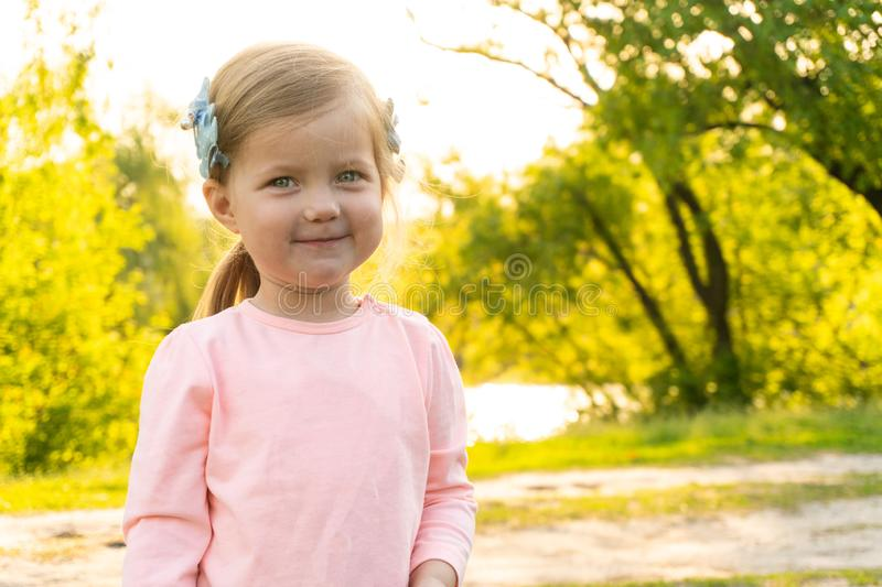 Very cute and adorable little girl looking in camera royalty free stock photos