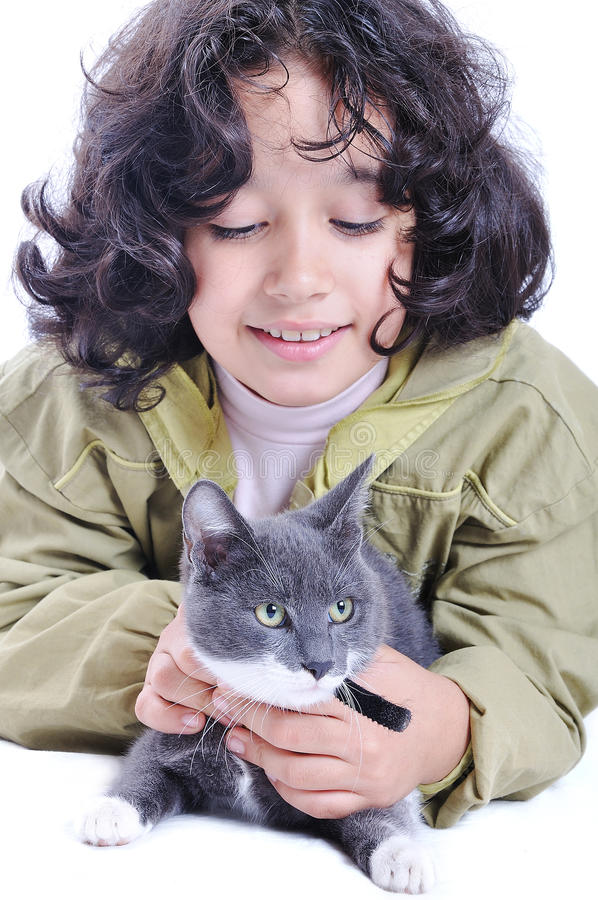 Download Very cute child with a cat stock image. Image of animal - 11414917
