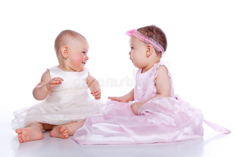 Very cute happy baby girls wearing princess dress stock photography
