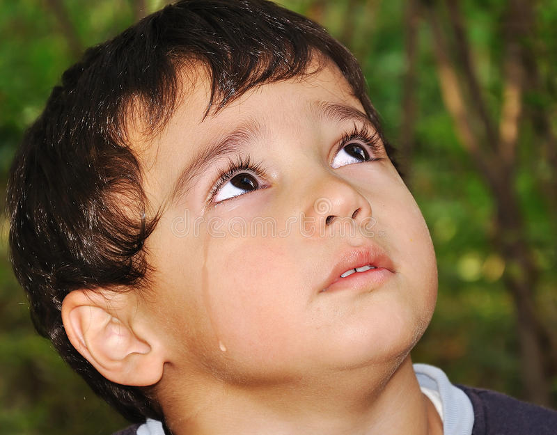 Very cute kid crying with true emotional tears. Very cute beautiful kid crying with true emotional tears stock image