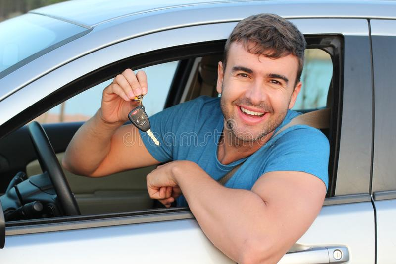 Very cute male driver showing car keys.  royalty free stock photo