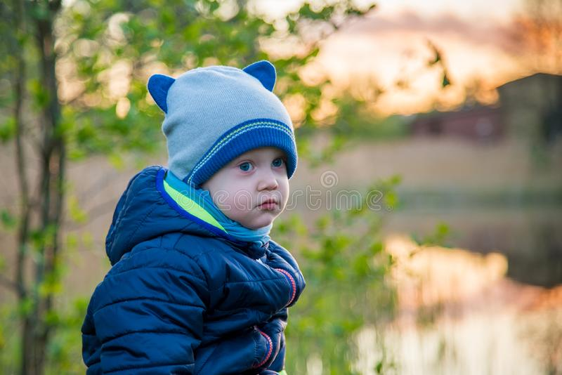 Very cute small toddler boy outdoors royalty free stock images