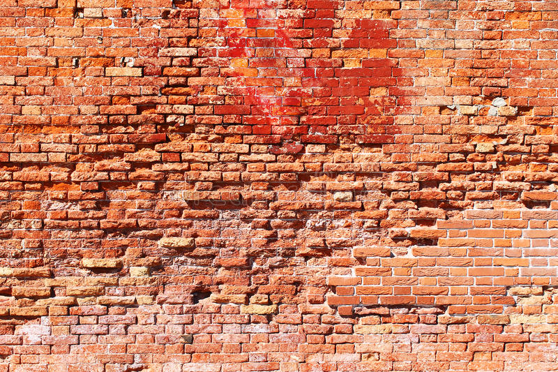 Very damaged old brick wall texture. Texture of an old and damaged brick wall from Venice, Italy royalty free stock photos