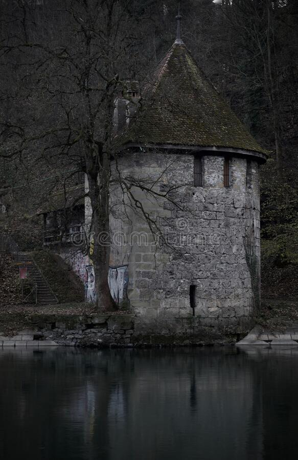 Very dark and sinister medieval tower. Dark medieval tower at the river Aare in Bern, Switzerland stock photography