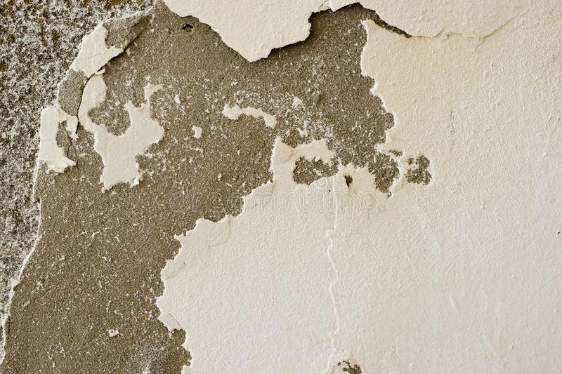 Very decomposed wall. Abstract decay and decadence. Background texture of a damaged and shriveled wall royalty free stock photo