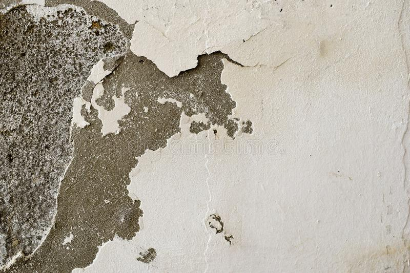 Very decomposed wall. Abstract decay and decadence. Background texture of a damaged and shriveled wall royalty free stock photography