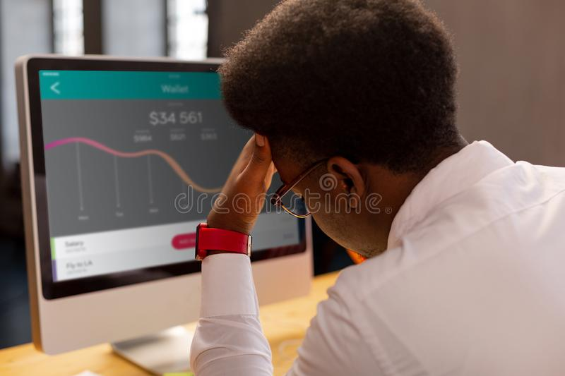 Nice tired man trying to concentrate on work royalty free stock photos