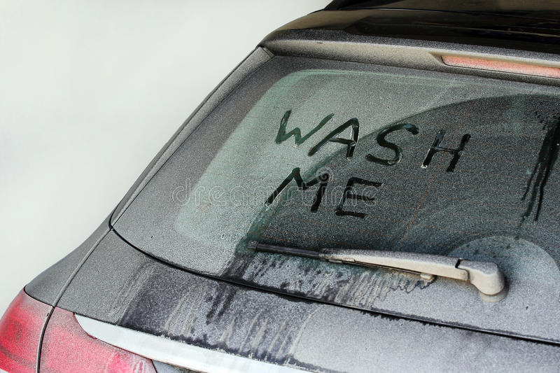 A very dirty car in winter. Wash me - A very dirty car in winter royalty free stock image