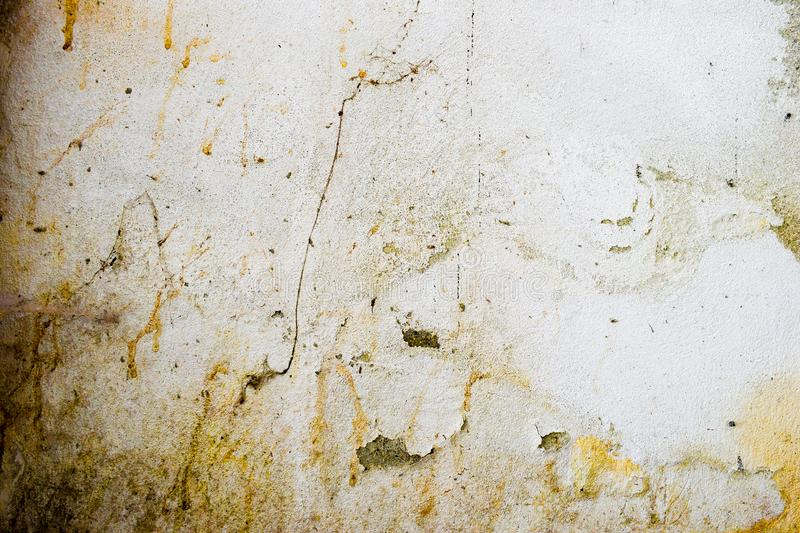 Very dirty and decomposed wall. Abstract painting and background texture of decay and decadence. Very dirty and decomposed wall. Abstract background texture of royalty free stock photography