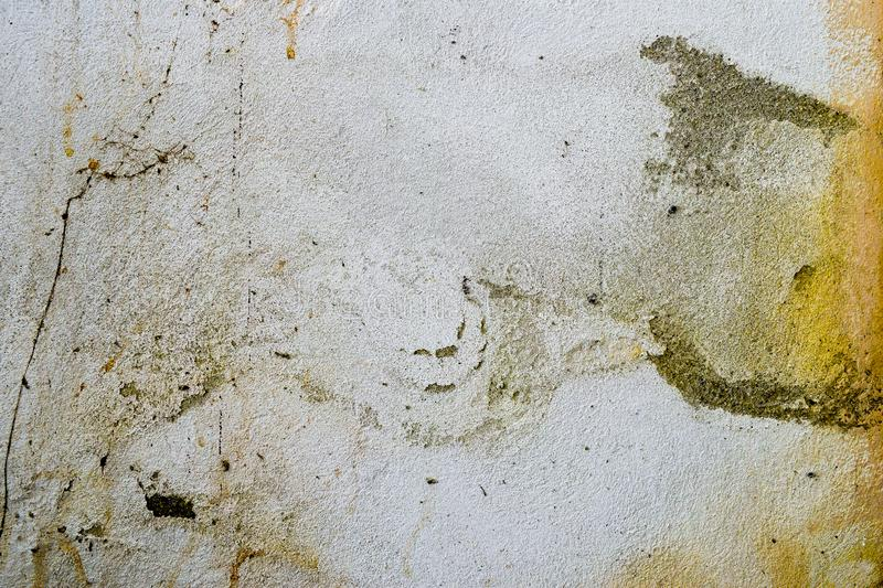 Very dirty and decomposed wall. Abstract painting and background texture of decay and decadence. Very dirty and decomposed wall. Abstract background texture of stock photos