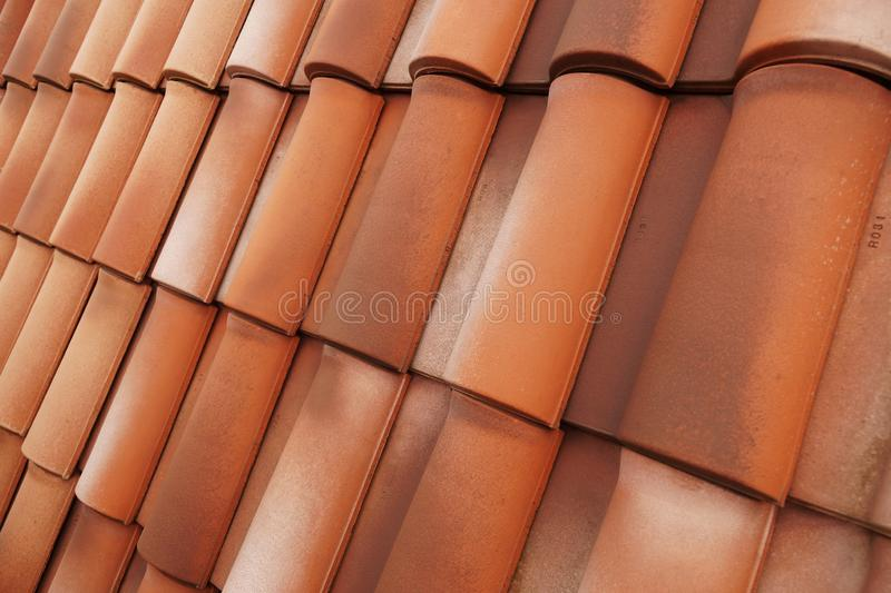 A classic ceramic tile in shape and color. Very durable roof cover. Very durable roof cover. A classic ceramic tile in shape and color stock images
