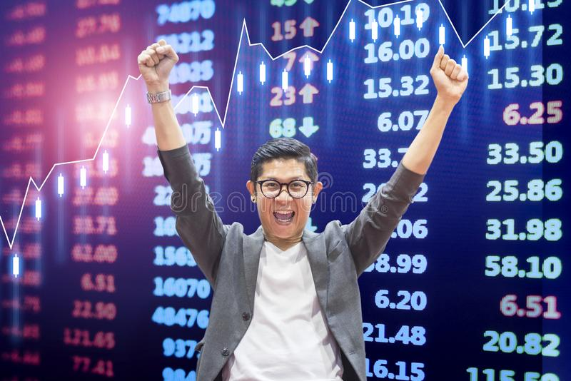 Very excited business man happy with stock market exchange growth up background stock images
