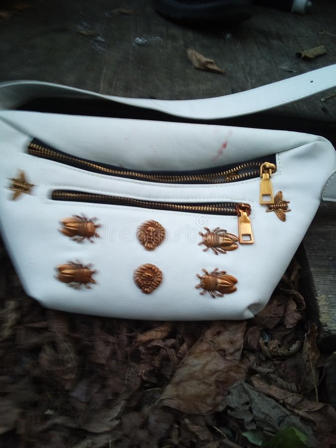 Very expensive purse but just found out it& x27;s a man& x27;s purse but women can also use it to stock photos