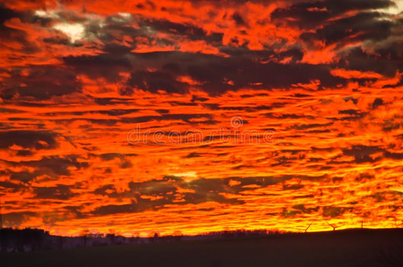 A very extraordinary and beautiful sunset in orange and purple colours. Lightened and bright royalty free stock photo