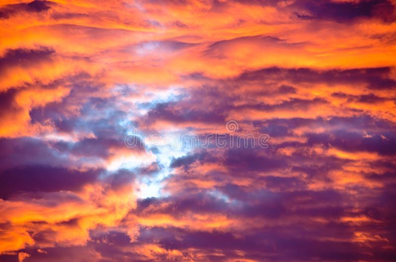 A very extraordinary and beautiful sunset in orange and purple colours. Lightened and bright royalty free stock photography