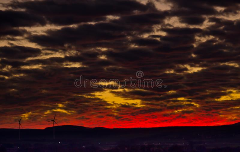 A very extraordinary and beautiful sunset in orange and purple colours. Lightened and bright stock image