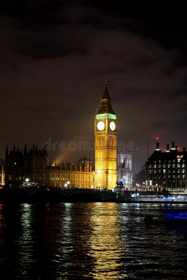 The very famous london icon of Parliament palace and Big Ben bell tower at dusk illuminated stock photo