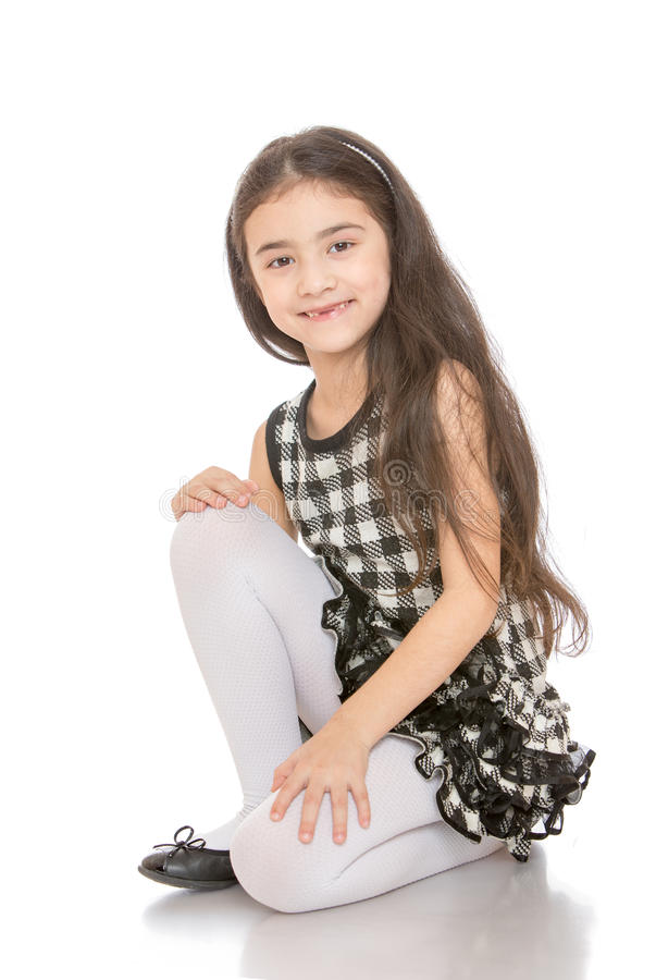 Very fashionable dark-haired little girl in a stock photo