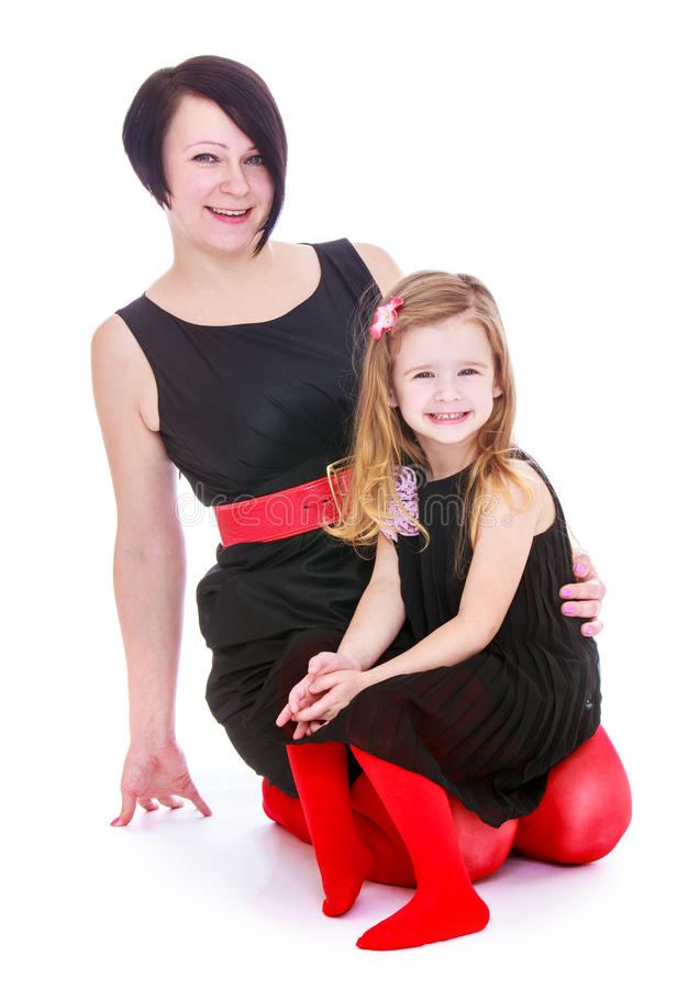 Very fashionable mom and little daughter stock image