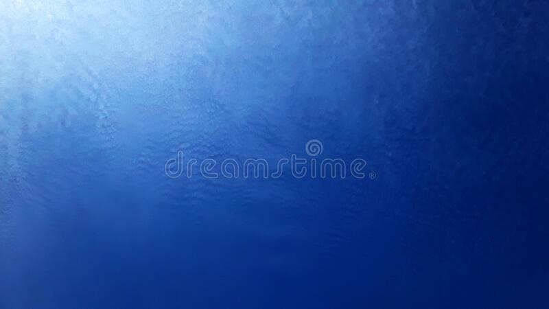Very few clouds. Clear Amazonian sky with very few clouds, the photo shows a gradient between the blue sky and a huge and extremely white cloud stock photography