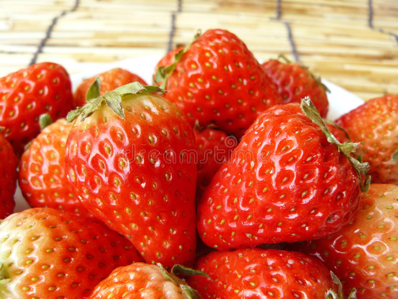 Very fresh harvested strawberries. Close up the group of very fresh harvested strawberries on the plate stock photo