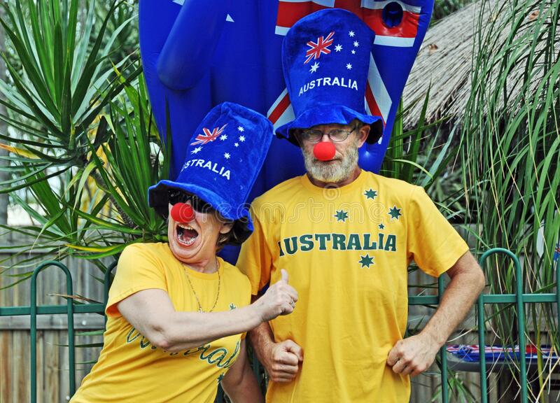 Funny senior couple having fun crazy costumes celebrating Australia Day royalty free stock photography
