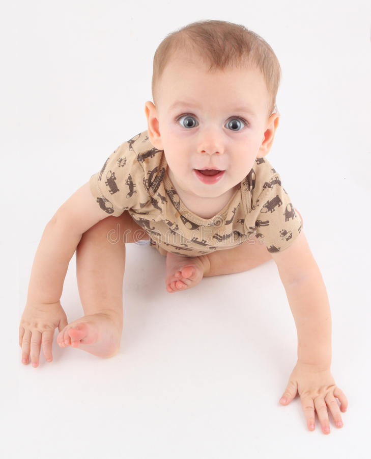 Very happy baby with blue eyes on the move stock photos