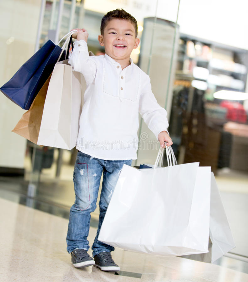 Happy boy holding shopping bags