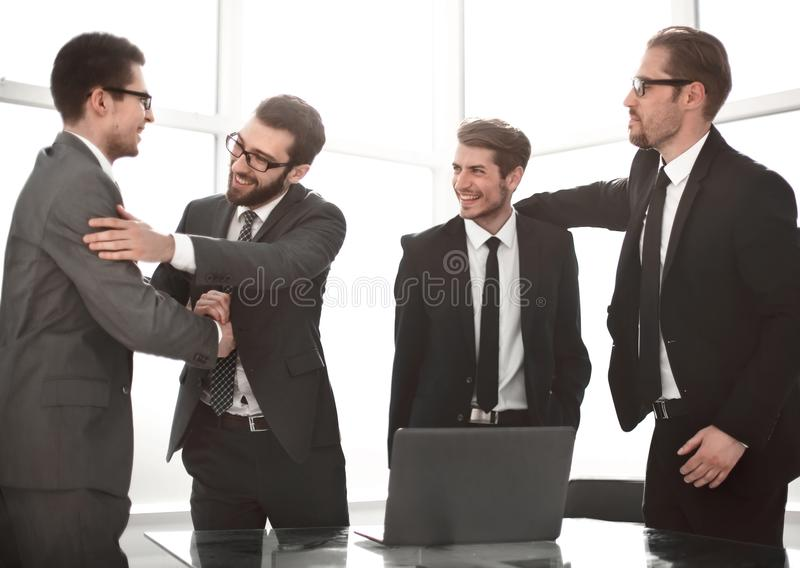 Very happy business colleagues standing in the office royalty free stock photos
