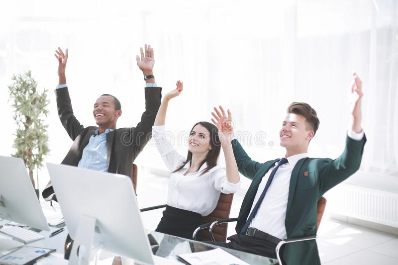 Very happy business team sitting at Desk stock photo